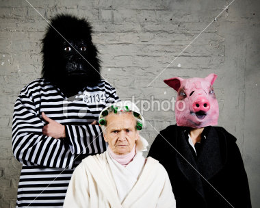 stock-photo-10527025-man-and-women-in-gorilla-pig-costume-or-old-lady